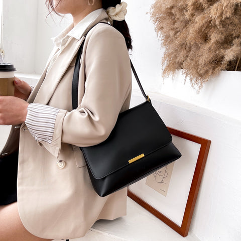 Metal hardware flap style PU leather crossbody bag