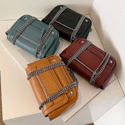 Zipped front flap studded PU leather crossbody bag