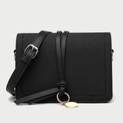Knotted strap metal disc embellished PU leather crossbody bag