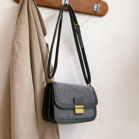 Metal closure flapover style PU leather suede shoulder bag