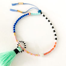Load image into Gallery viewer, Shop this colorful and delicate Beaded Bracelet with Aqua Tassel - Handmade & Adjustable at Federal & Black