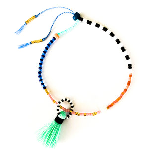 Shop this colorful and delicate Beaded Bracelet with Aqua Tassel - Handmade & Adjustable at Federal & Black