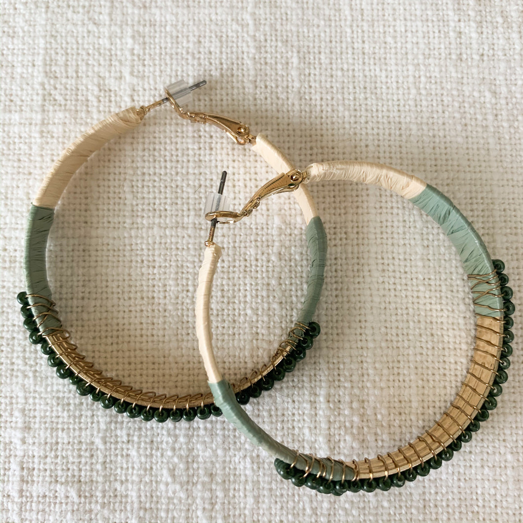Shop our beaded raffia wrapped hoop earrings in green at Federal & Black