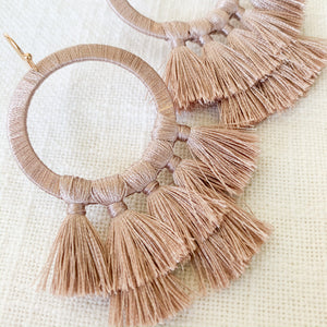 Shop our thread wrapped circle & tassel earrings in dusty pink at Federal & Black