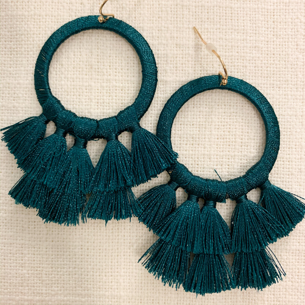 Shop our thread wrapped circle & tassel earrings in emerald green at Federal & Black