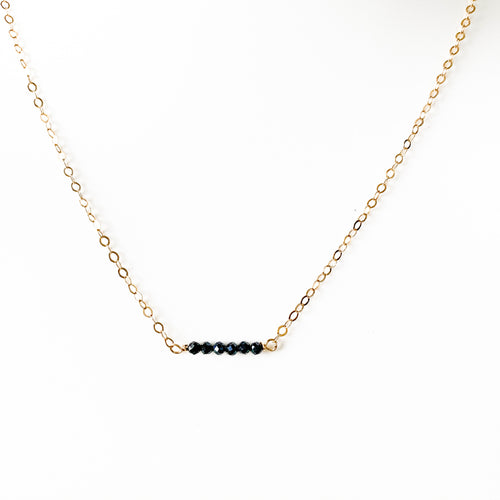 Delicate 14k gold necklace with Metallic Black Spinel Stones at Federal & Black