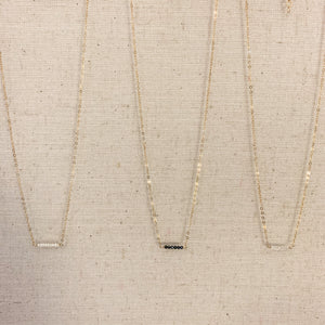 Delicate 14k gold necklace with Herkimer Diamond or Metallic Black Spinel Stones at Federal & Black