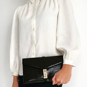 Shop the Black Crocodile Embossed Clutch with Gold Turn Lock at Federal & Black