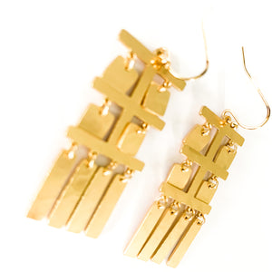 Shop the gold plated Geometrical Tassel Earrings at Federal & Black