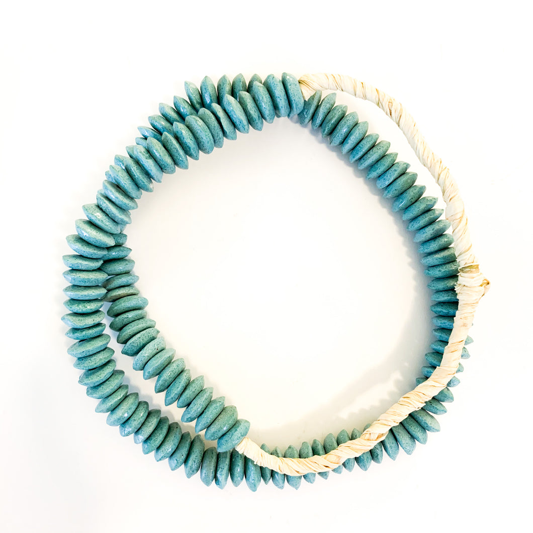 Shop our handmade glass beaded necklaces like this one, Ashanti Glass Saucer Beads in Turquoise at Federal & Black