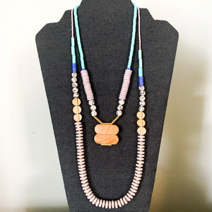 Shop the Lavender Seed Bead, Dalmation & Brass Statement Necklace at Federal & Black