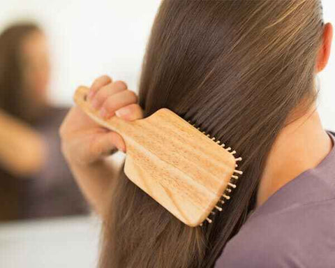 Appropriate brushing of your hair- No to Dandruff