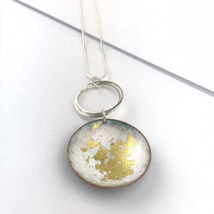 White and gold 'bowl' statement enamel pendant.