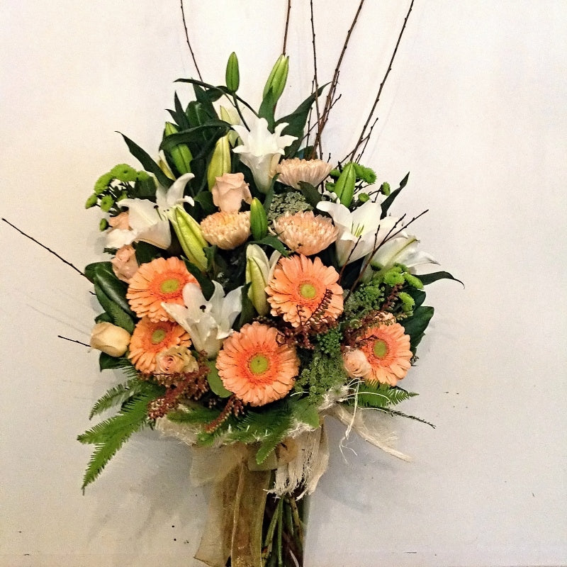 Vase of gerbera's, lilies, and roses