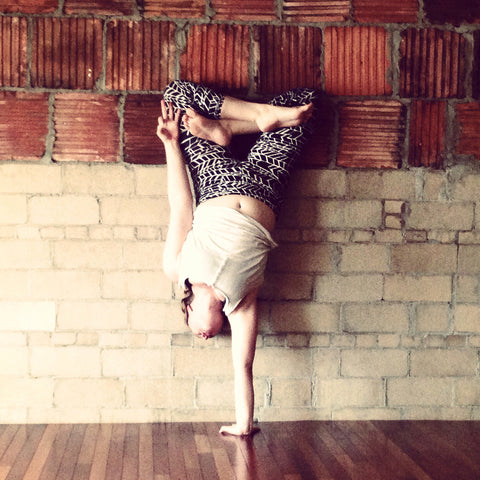 Your body is your temple. Woman doing yoga handstand.