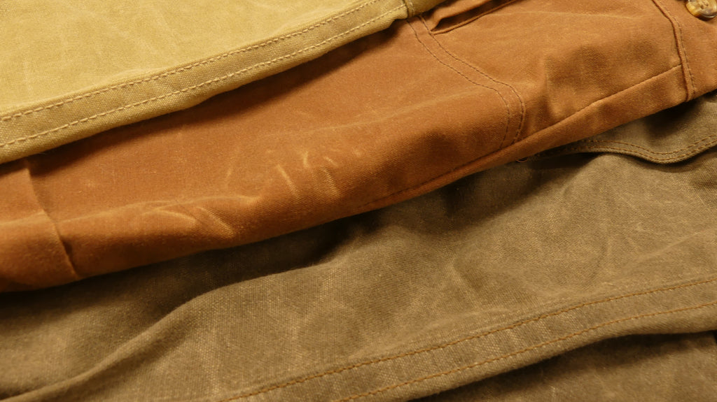 Stack of waxed canvas jackets