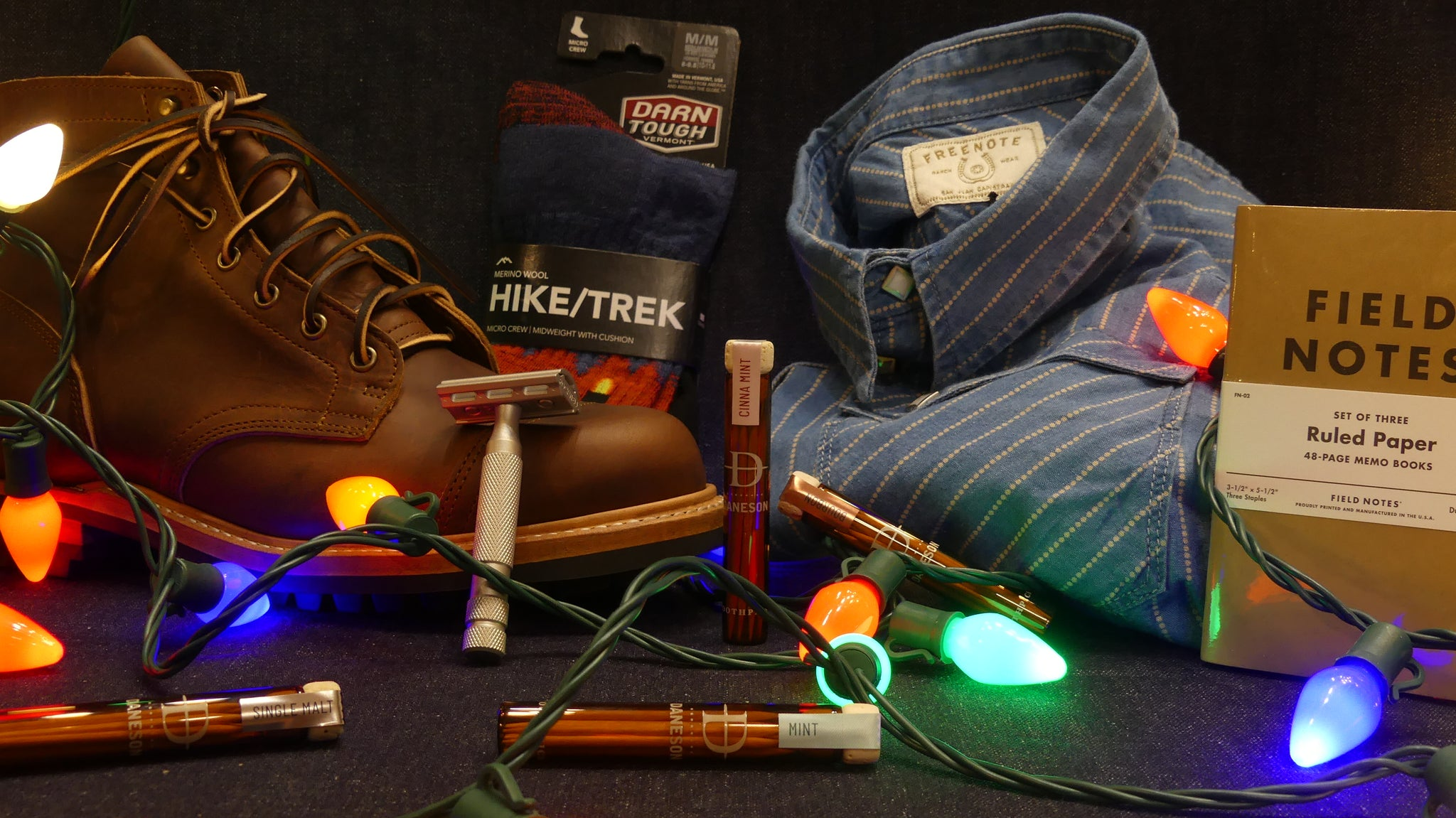 Items carried at Porterhouse on a denim backdrop with Christmas lights