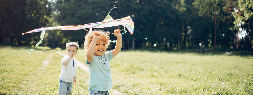 A young man playing with a kite