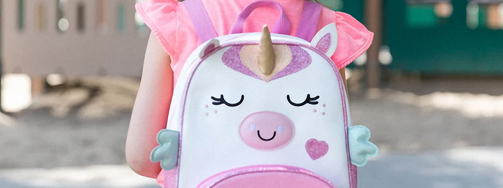 Girl with a unicorn backpack