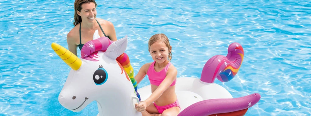 daughter and mother in pool with a Unicorn Pool Float