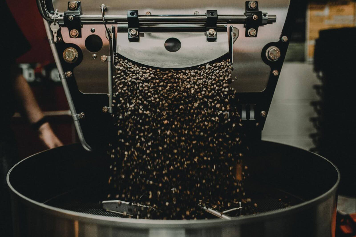 Coffee pouring into our roaster