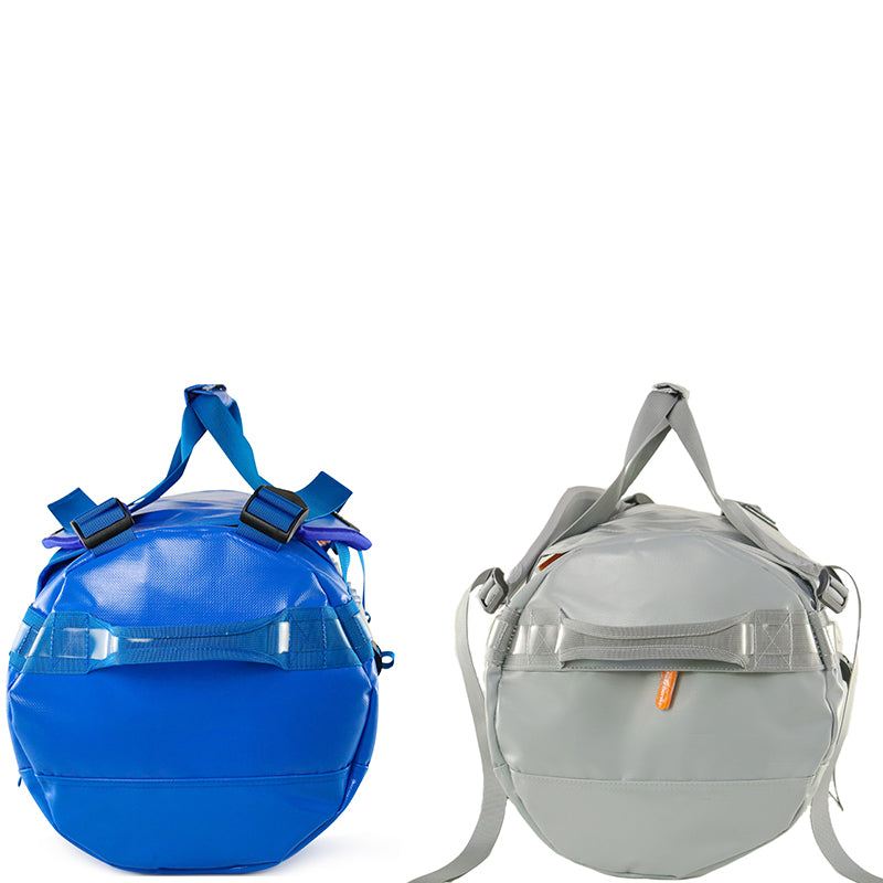side view of blue and grey barrel bags with carry handles and zipper pocket