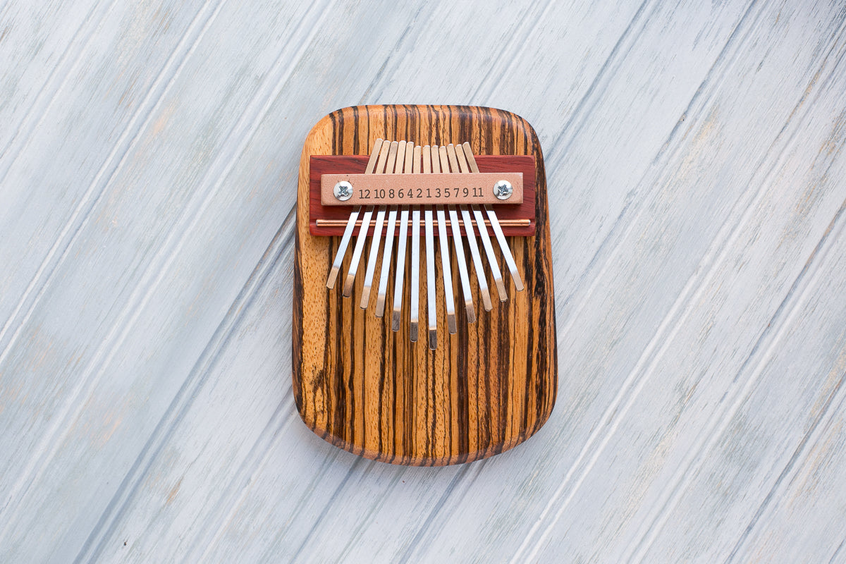 Zebrawood 12 Key Thumbp Piano - Zip & Mos