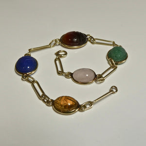 Each cabochon in this bracelet is set inside a bezel, and has the Scarab Beetle etched into it.  Bracelet Weight: 7.90g  Length: 21CM  Hallmark: None visibile  Acid tested as 14ct. @ Delross Jewellers