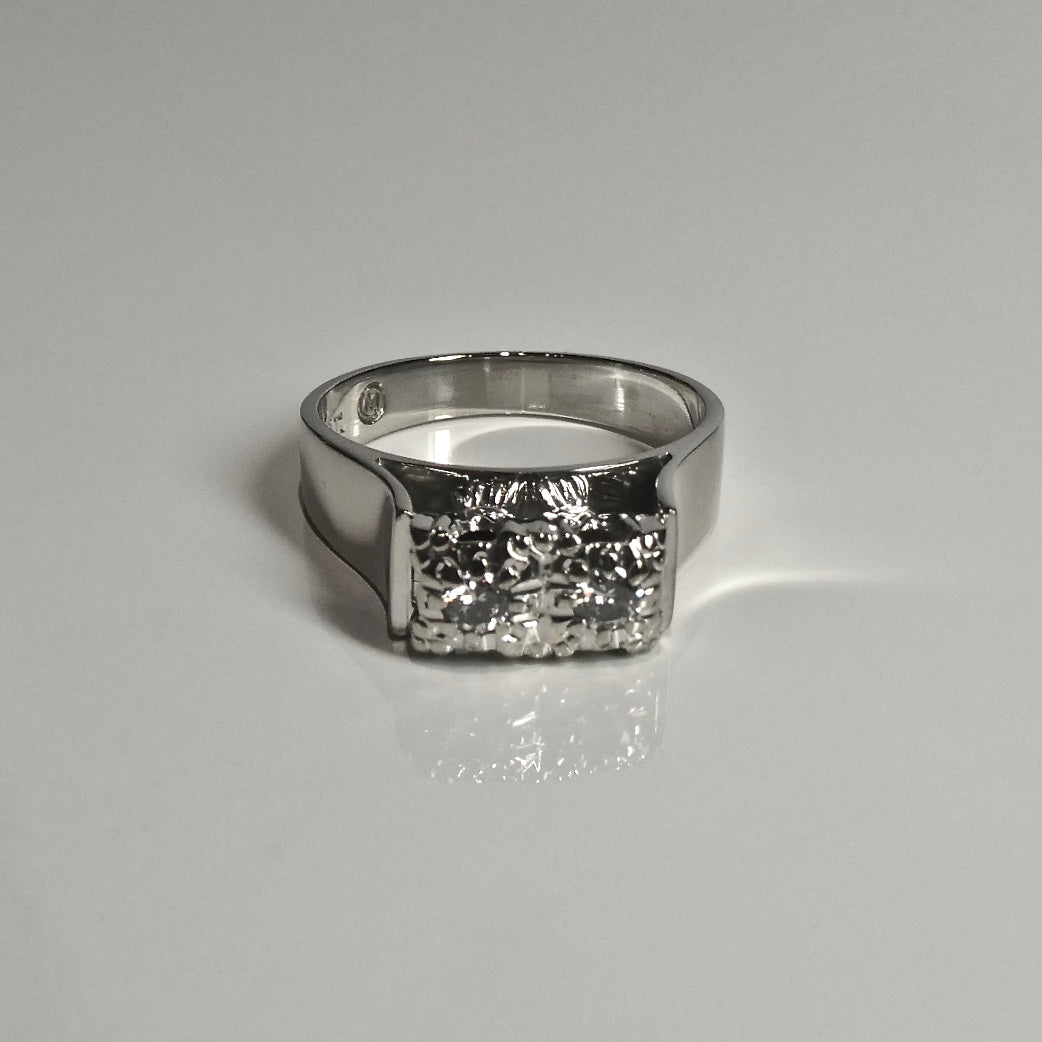 Vintage Diamond Ring featuring two 2.5mm Round Brilliant Cut Diamonds set in a bright cut setting.
