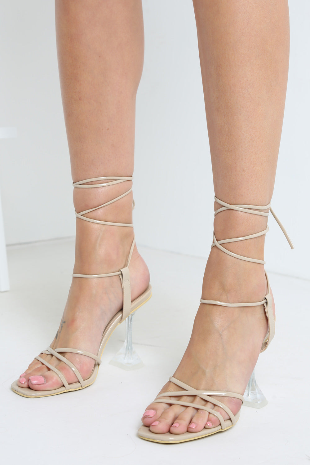 Nude Patent Wrap Around Cleat Block Heels