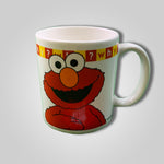 Load image into Gallery viewer, Sesame Street ELMO Muppet General Store WHY? Mug