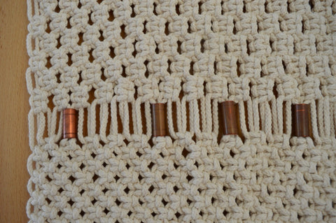 Long off white macrame wallhanging with copper details