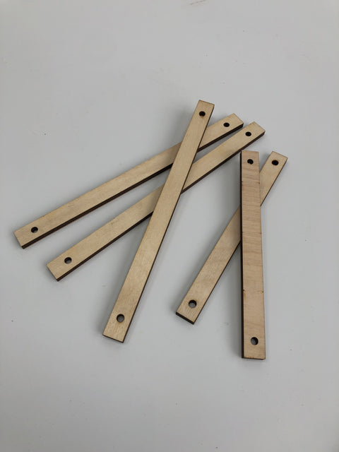 Birch wooden, lasercut sticks with two holes. In two sizes. Perfect to hang your work!