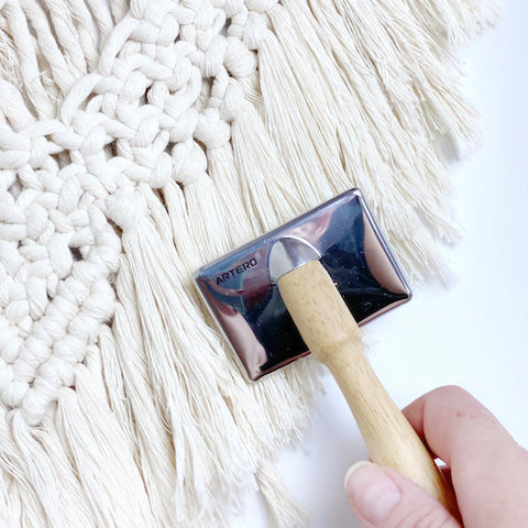 Metal/wooden fiber brush (to comb that beautiful fringe)