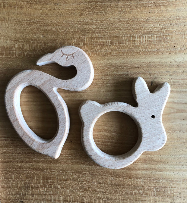 Wooden baby teether in 8 different (animal) shapes