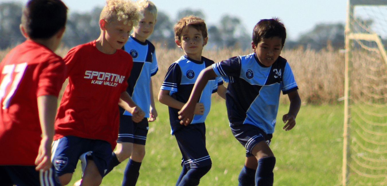 Topeka Soccer Club players chase the soccer ball during the Harvest Cup tournament in Topeka, Kansas.