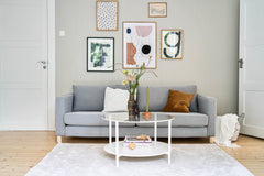 Living room with picture wall and round table