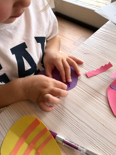Photo of child making paper easter decorations