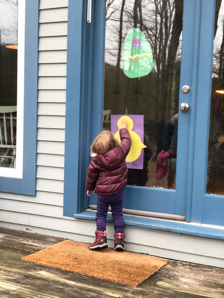 Photo of daughter with paper easter decorations