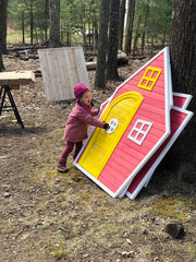 Photo of daughter with outdoor playhouse