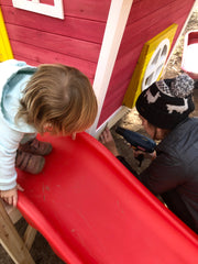 Photo of mom and daughter building outdoor playhouse