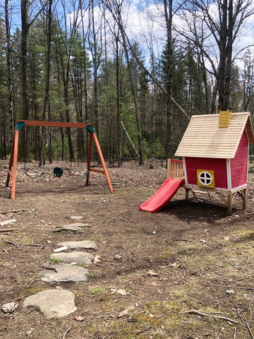 Photo of finished swing set and playhouse
