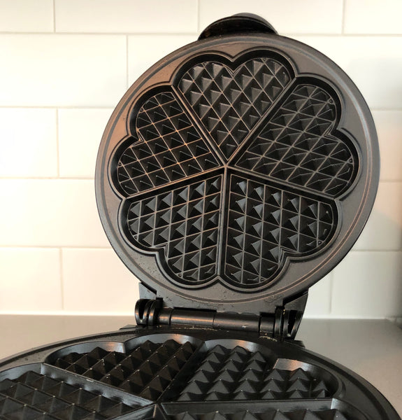 Photo of open waffle iron