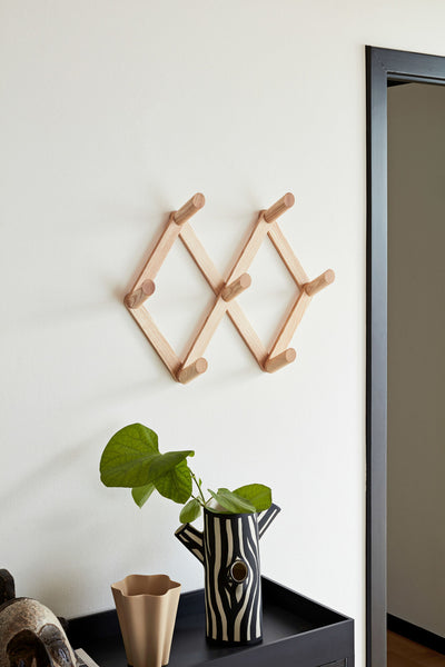 Accordion coat rack from Hay mounted on wall in living room