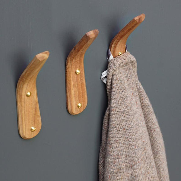 Three steam-bent wooden coat hooks from Layertree