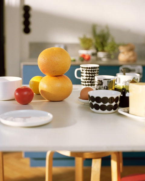 breakfast table decorated with marimekko home goods and textiles