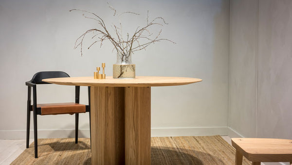 Scandinavian wood dining furniture exhibited at the Stockholm furniture fair