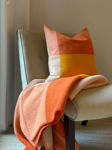 Syndin pillow and blanket from Røros Tweed on chair