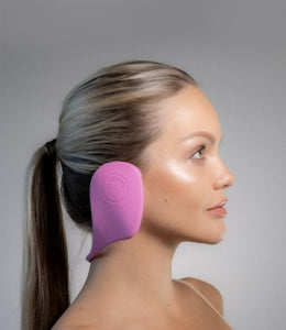 side view of white woman wearing pink ear loves