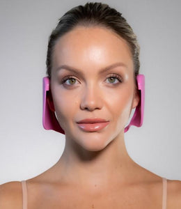 front facing woman model wearing pink ear loves